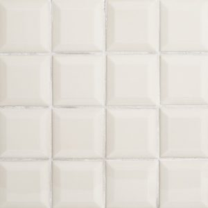 A beige / cream ceramic beveled field tile by Jeffrey Court.