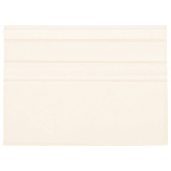 A beige / cream ceramic architectural mouldings grand moulding tile by Jeffrey Court.
