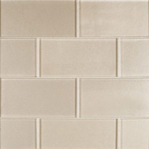 A beige / cream glass field tile by Jeffrey Court.