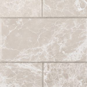 A beige / cream natural stone beveled field tile by Jeffrey Court.