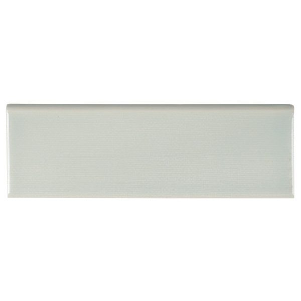 A blue ceramic trim single bullnose tile by Jeffrey Court.