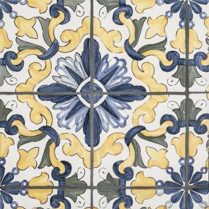 A blue / yellow terra cotta decorative element lisbon 4-piece pattern tile by Jeffrey Court.