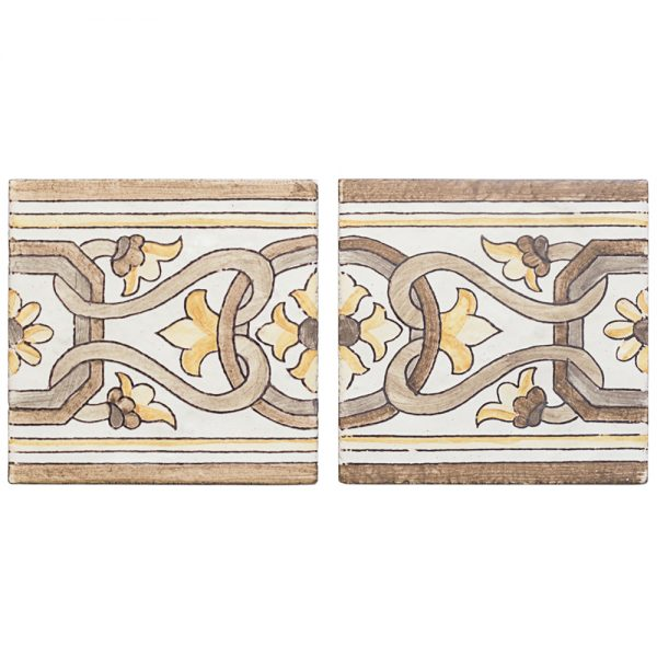 A brown terra cotta border/listello alentejo pattern tile by Jeffrey Court.