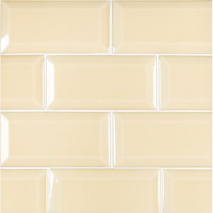 A gold / yellow ceramic beveled field tile by Jeffrey Court.