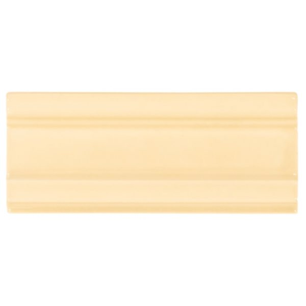 A gold / yellow ceramic architectural mouldings sash moulding tile by Jeffrey Court.