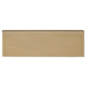 A gold / yellow ceramic trim single bullnose tile by Jeffrey Court.
