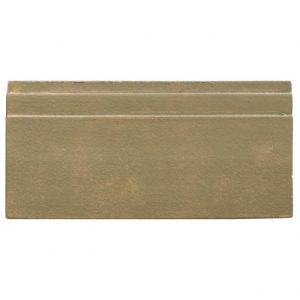 A green terra cotta architectural mouldings base tile by Jeffrey Court.