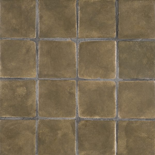 A green terra cotta stained insert tile by Jeffrey Court.