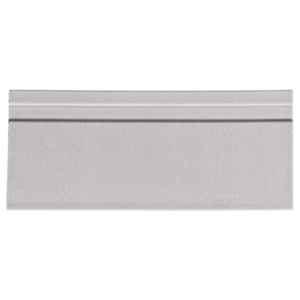 A grey ceramic architectural mouldings base tile by Jeffrey Court.