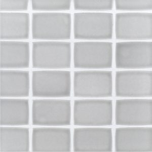 A grey ceramic mosaic retro tile by Jeffrey Court.