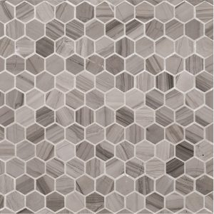 "A grey natural stone mosaic 1"" hexagon tile by Jeffrey Court."