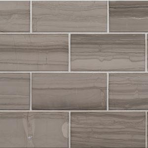 A grey natural stone beveled field tile by Jeffrey Court.