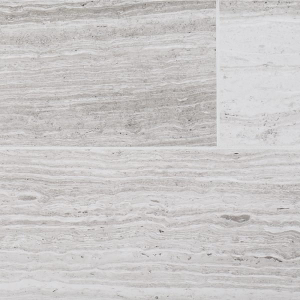 A grey natural stone field tile by Jeffrey Court.
