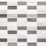 A grey natural stone mosaic modernique pattern tile by Jeffrey Court.
