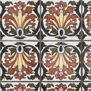 A red / green terra cotta border/listello litoral pattern tile by Jeffrey Court.