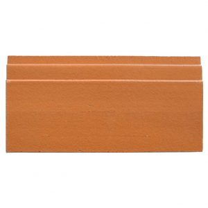 A red terra cotta architectural mouldings base tile by Jeffrey Court.