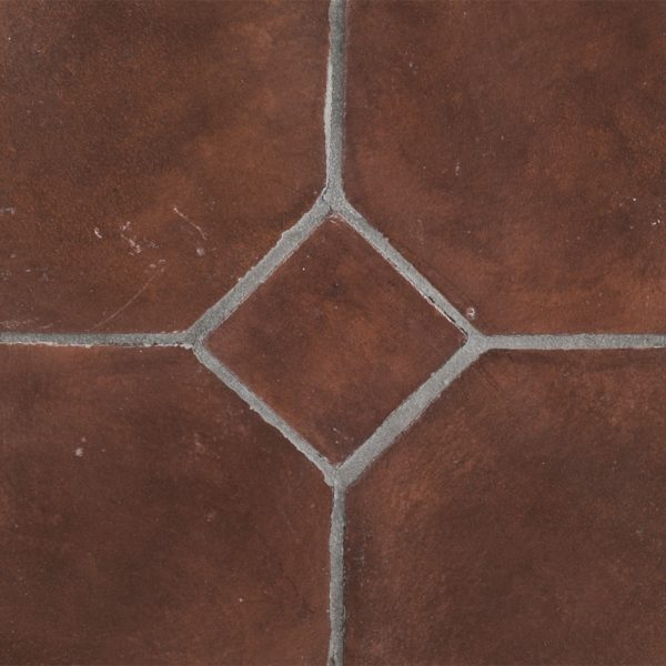 A red terra cotta octagon field tile by Jeffrey Court.
