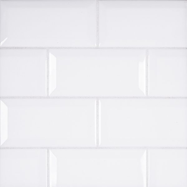 A white ceramic beveled field tile by Jeffrey Court.