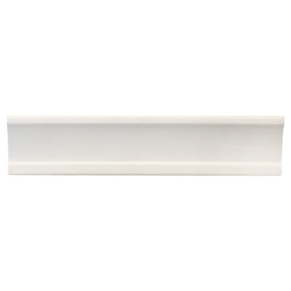 A white ceramic architectural mouldings crown tile by Jeffrey Court.