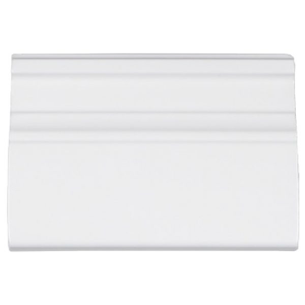 A white ceramic architectural mouldings grand moulding tile by Jeffrey Court.