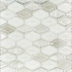 A white glass mosaic beveled elongated hex tile by Jeffrey Court.