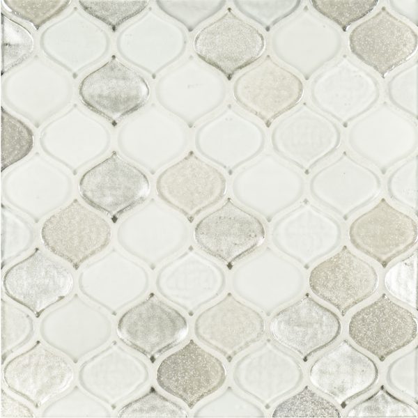A white glass mosaic droplet tile by Jeffrey Court.