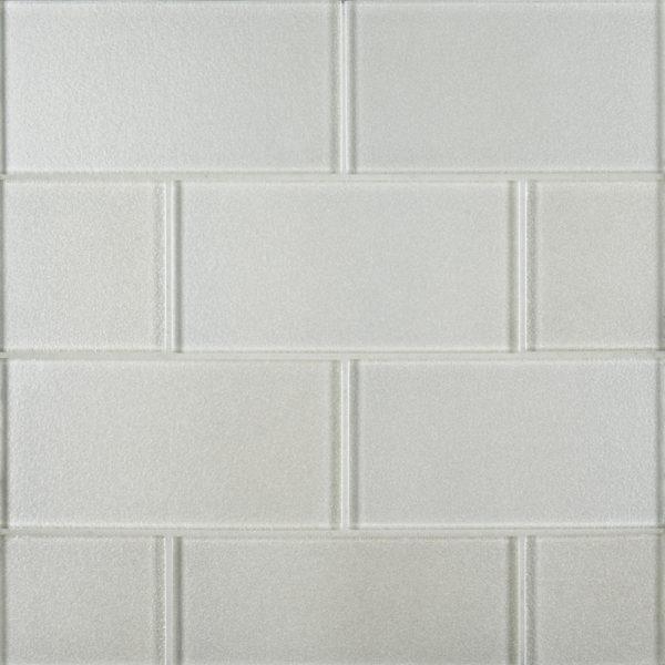 A white glass field tile designed by Jeffrey Court.