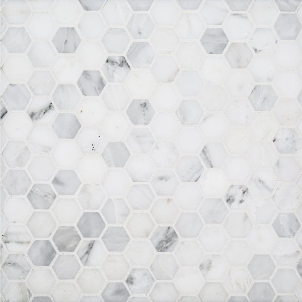 "A white natural stone mosaic 1"" hexagon tile by Jeffrey Court."
