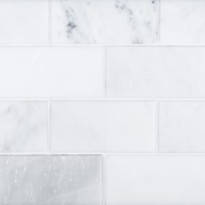 A white natural stone beveled field tile by Jeffrey Court.