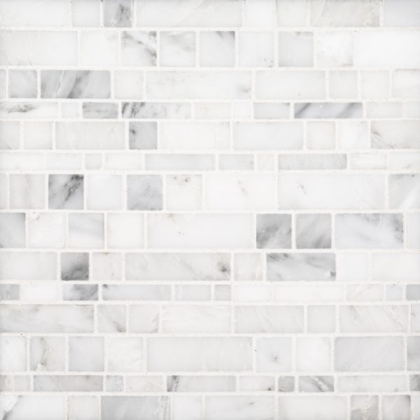A white natural stone mosaic moderna pattern tile by Jeffrey Court.