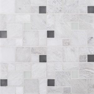 A white natural stone mosaic winward plains tile by Jeffrey Court.