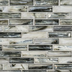 A beige / cream glass mosaic hour glass tile by Jeffrey Court.