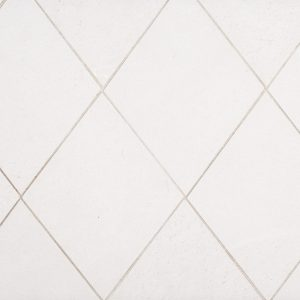A beige / cream natural stone diamond field tile by Jeffrey Court.