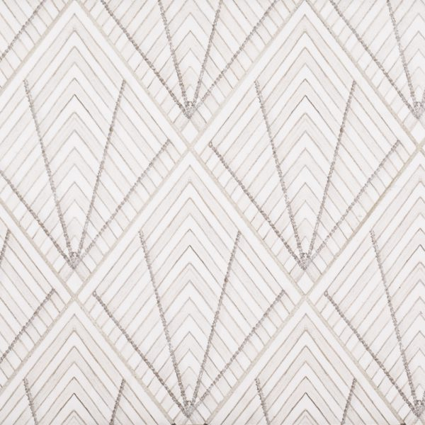 A beige / cream natural stone decorative element drawn stone diamond tile by Jeffrey Court.