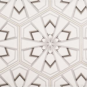 A beige / cream natural stone decorative element drawn stone hex tile by Jeffrey Court.