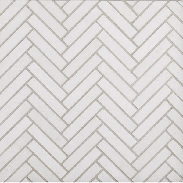 A beige / cream natural stone mosaic herringbone styx tile by Jeffrey Court.