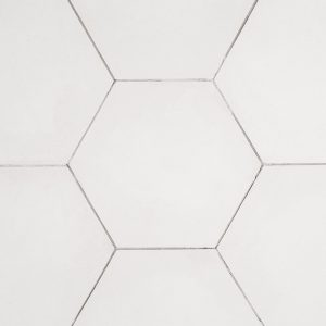 A beige / cream natural stone hex field tile by Jeffrey Court.