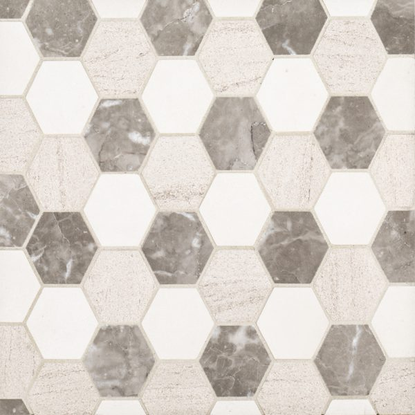 A beige / cream natural stone mosaic hex mixed medley tile by Jeffrey Court.