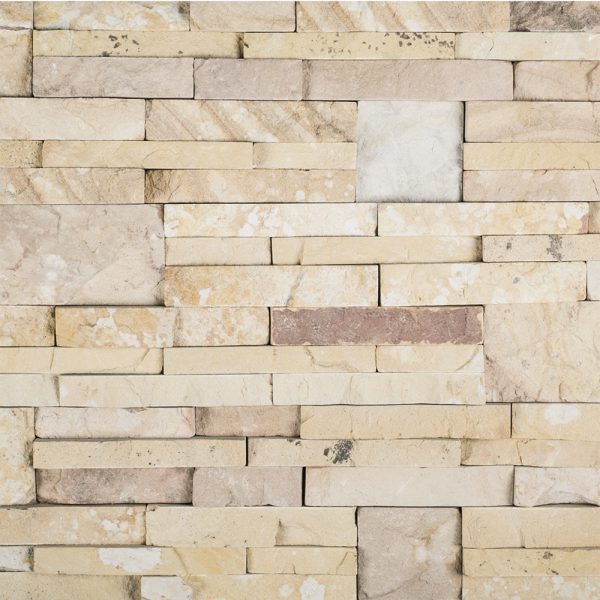 A beige / cream natural stone field ledger panel tile by Jeffrey Court.