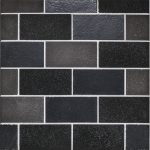 "A black natural stone mosaic 2"" x 4"" brick tile by Jeffrey Court."
