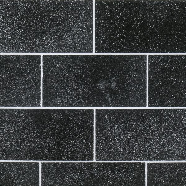 A black natural stone field tile by Jeffrey Court.