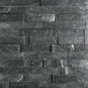 A black natural stone field ledger panel tile by Jeffrey Court.
