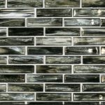 A grey glass mosaic hour glass tile by Jeffrey Court.