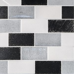 "A grey natural stone mosaic 2"" x 4"" brick tile by Jeffrey Court."