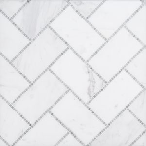 A grey natural stone mosaic gapstow tile by Jeffrey Court.