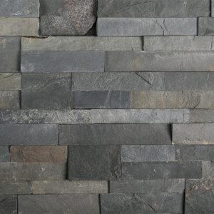 A grey natural stone field ledger panel tile by Jeffrey Court.