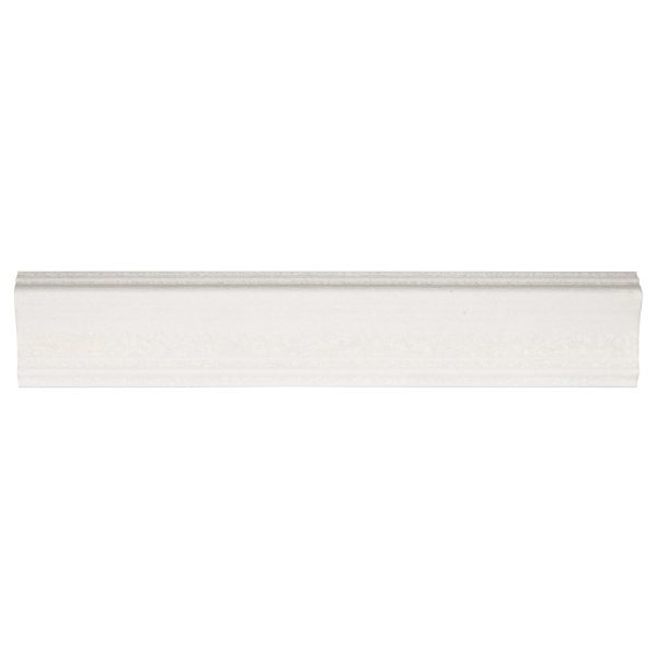 A white ceramic architectural mouldings atlas crown tile by Jeffrey Court.