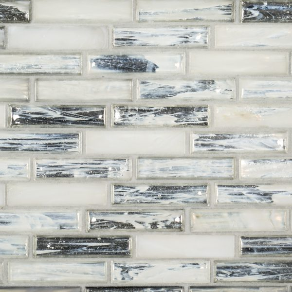 A white glass mosaic hour glass tile by Jeffrey Court.