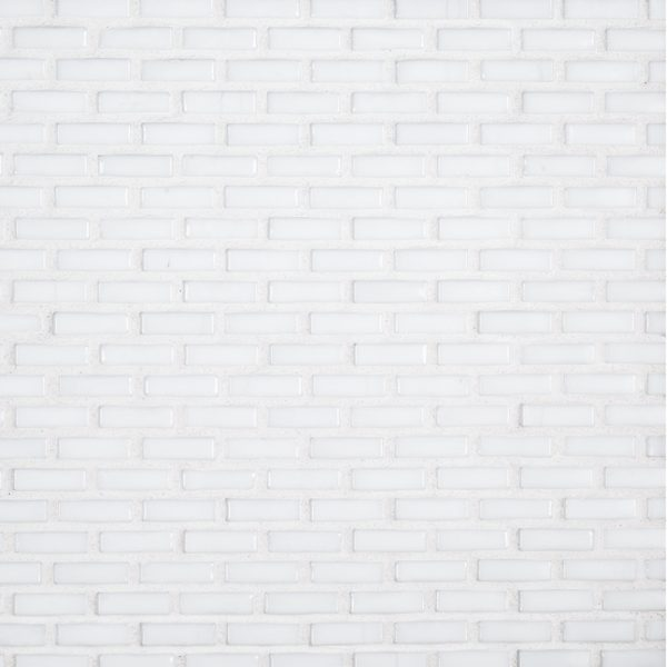 A white glass mosaic industrie glass tile by Jeffrey Court.