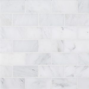 "A white natural stone mosaic 2"" x 4"" brick tile by Jeffrey Court."